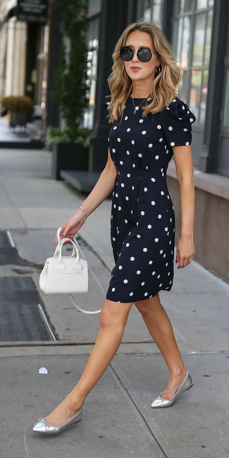 3 Day-To-Night Dresses You Need // Navy and white polka dot dress with shoulder …