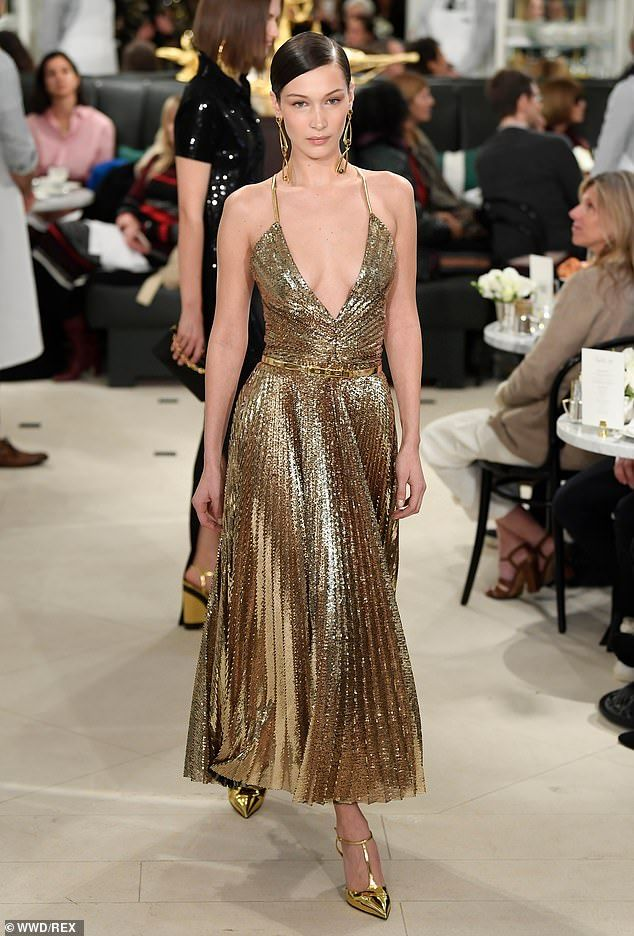 Bella Hadid takes the plunge in metallic gold gown at NYC fashion show