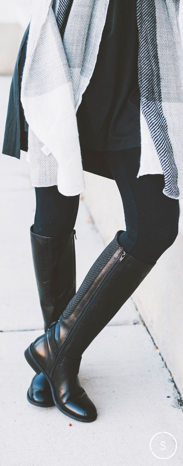 Go knee-high with your black boots for a playful look with leggings and a cozy s…