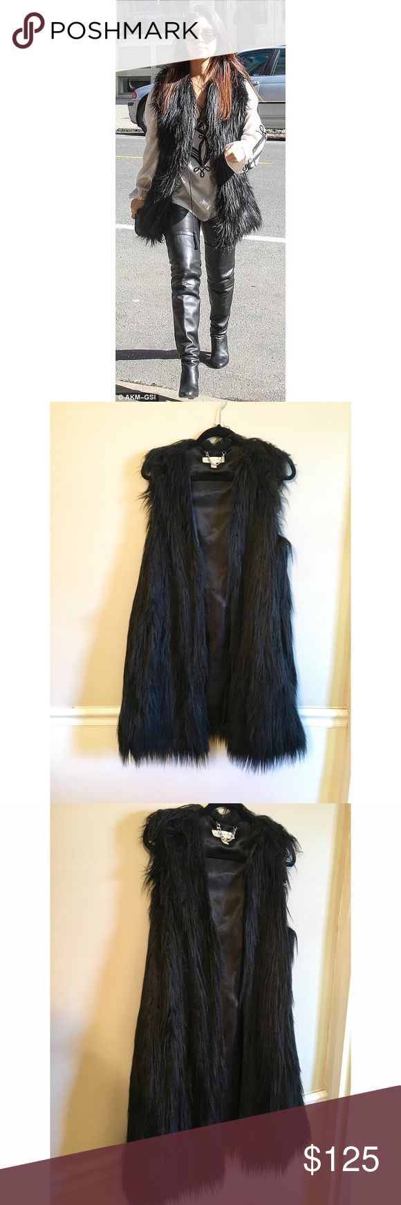 Long Black Faux Fur Vest Size Large There's no better way to stay warm and g…