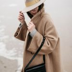 Ocean editorial by The Fashion Cuisine Beatrice Gutu wearing oversized camel coa...