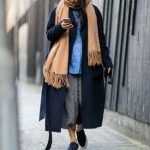 Opt for a navy coat and grey culottes for a glam and trendy getup. Opt for a pai...