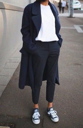 Reach for a navy coat and black dress pants to achieve a neat and proper look. T…