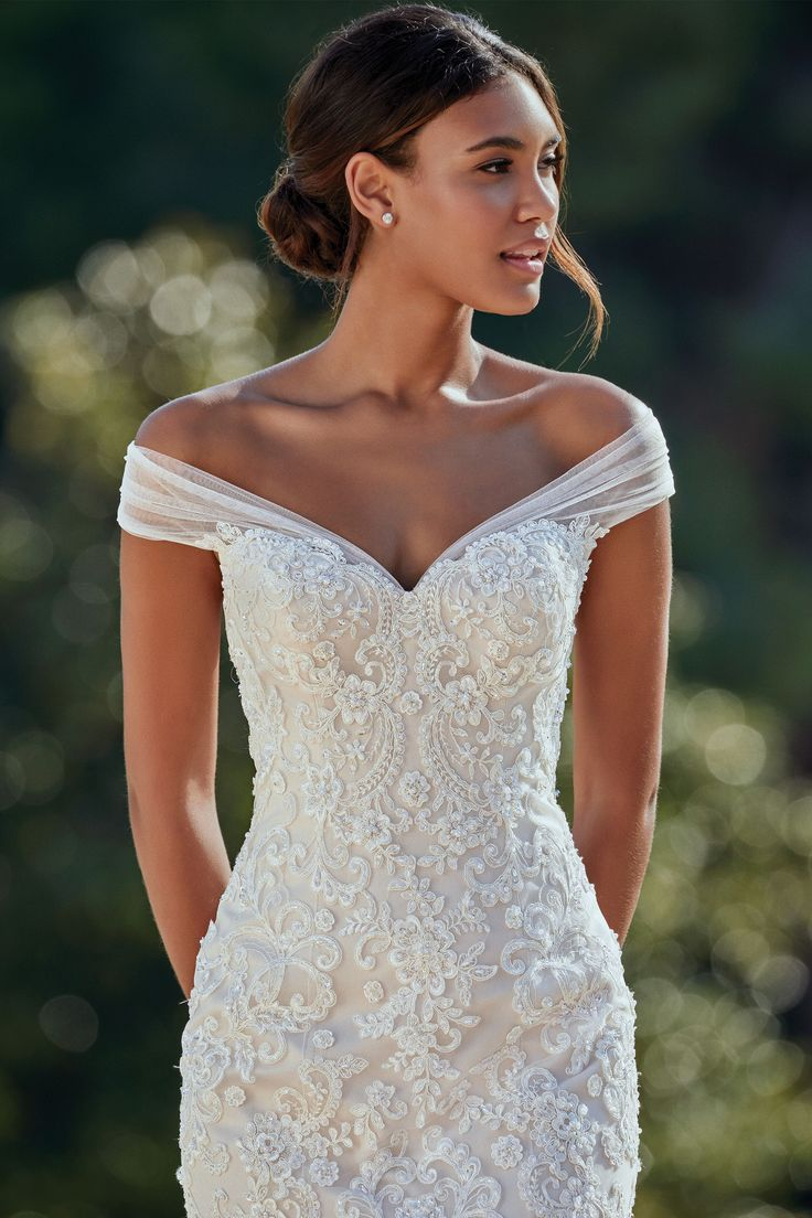 Sincerity – #44148 – Fitted lace bodice wedding gown with a dramatic tulle skirt…