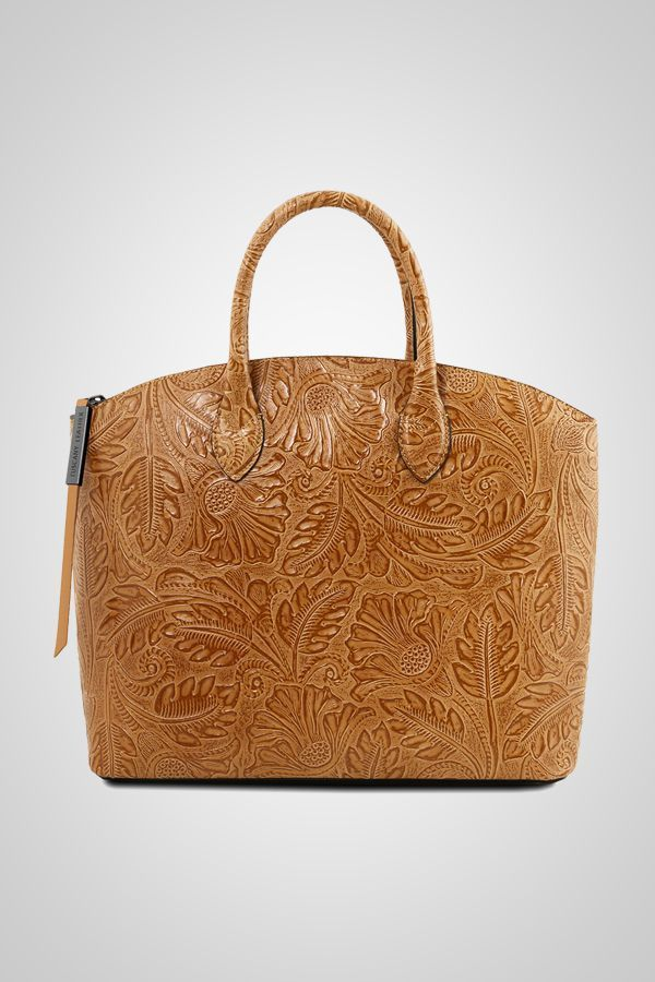 The pattern embossed on this Italian leather bag gives you a bag like no other. …