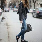 Try pairing a black leather biker jacket with blue ripped skinny jeans for a com...